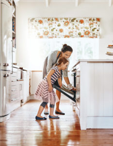 Shot of a little girl baking with her mother in the kitchen